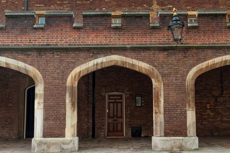 A small door leading to one of the Royal Residences of London, United Kingdom. The door is pretty modest when you think of the house it belongs to. Stock Photo