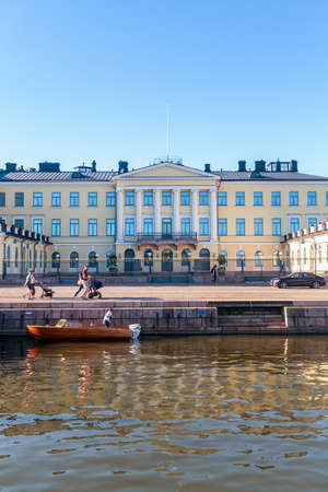 A wooden boat has been parked by the presidential palace at Helsinki, the capital of Finland.