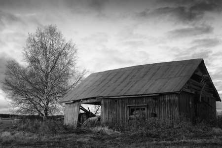 The setting sun lights up the old abandoned barn house. The autumn evenings are beautiful with very dramatic skies.