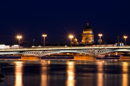 blagoveshchensky: Blagoveshchensky (Leuteinant Schmidt) bridge and St. Isaac Cathedral in St.Petersburg, Russia. White night view from embankment.