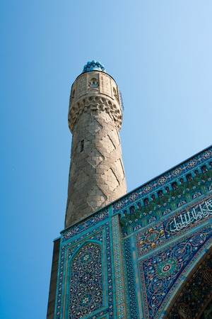 The cupola of St. Petersburgs cathedral mosque on the blue sky background. Ceramic pattern.