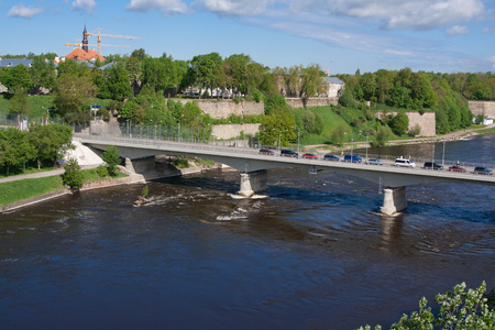 Bridge of Friendship with pedestrian tunnel over Narova River between Narva in Estonia and Ivangorod in Russia.