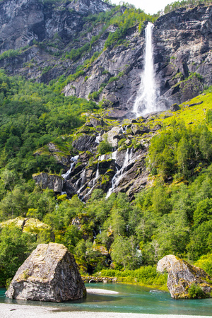 Giant Rjoandefossen waterfall by the Flam to Myrdal Railway Line Norway