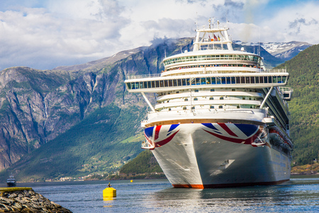Large Cruise ship departure in the port of Flam to Stavanger, in sunny summer day, Norway. Stock fotó