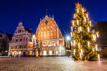 Riga, Latvia. Panorama Of Town Hall Square, Popular Place With Famous Landmarks On It In Bright Evening Illumination In Winter Twilight. Winter New Year Christmas Holiday Season. Stock Photo