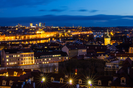 Beautiful Night view over the Vltava river, Charles bridge, the embankment Smetanovo, tower old city, Church St. Assisi and whole Prague. Popular European travel destination. Chech Republic. Stock Photo