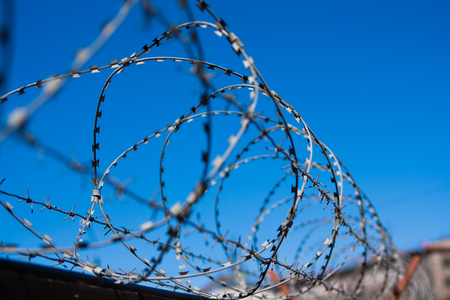 barbed wire on the background of blue sky. Russia Saint Petersburg
