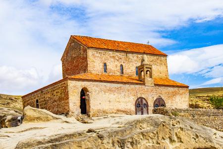 Beautuful View to Ancient Orthodox Church in mount in antique cave city Uplistsikhe. The Uplistsikhe 9th-10th century three-nave basilica and vale of Mtkvari river, Shida Kartli, Gori, Georgia