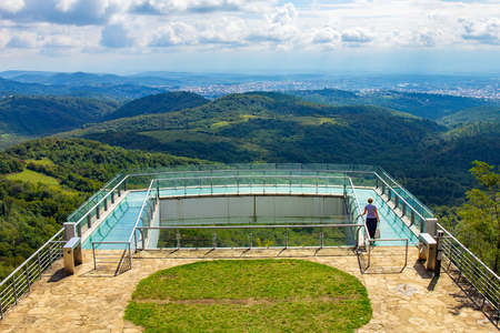 Kutaisi, Georgia caucasus region. Beautiful view to glass bottomed Observation Platform With Clear Floor At Highest Point Of State Sataplia Reserve With Wonderful View Of Kutaisi And Its Surroundings.
