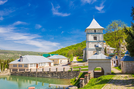 Beautiful view to Kalarashovsky Holy-Uspensky woman monastery in sany sammer day. Convent located on the right Bank of the Dniester near Kalarashovka village Moldova. Convent founded in XVI century.