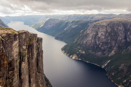Aerial view of Lysefjorden from the mountain Kjerag, with waterfall on the cliff and mountains in background, in Forsand municipality in Rogaland county, Norway. Stock Photo