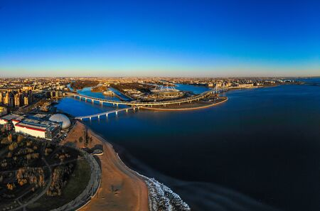 Beautiful view to new Stadium Zenit - Arena, highway, Gulf of Finland, Pedestrian bridge on sunny summer day. Top panoramic view aerial drone. St. Petersburg city, Russia
