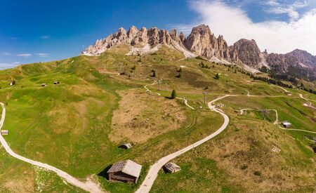 Aerial top view from drone to wonderful alpine landscape and meadows at Pass Gardena with majestic Sella mountain group in Dolomiti. Alps, South Tirol, Dolomites mountains, passo di Val Gardena, Italy Stock Photo