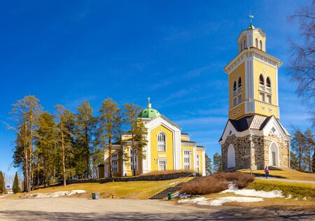 beautiful view of ancient Lutheran Church whith bell tower in kerimaki of southern Savo province on a sunny spring day. The biggest wooden cathedral in Scandinavia and in the world. Eastern Finland