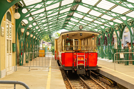 Funicular tramway whith Vintage passenger tram cars. Italian mountain electric train departs from SASSI station to the Basilica Di Superga Church Cathedral. Alpine mountains, TURIN, Piedmont, ITALY.