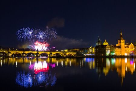 Colorful fireworks over Charles bridge and the river Vltava. The historical center of Prague. The Czech Republic 2018 year