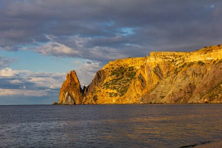 Scenic view from Jasper beach near St. George Monastery to Cape Fiolent in sunny summer day. Rocky coast black sea and cliff, Sevastopol, Crimea, Russia, Ukraine. Landscape Mountains surround the bay.