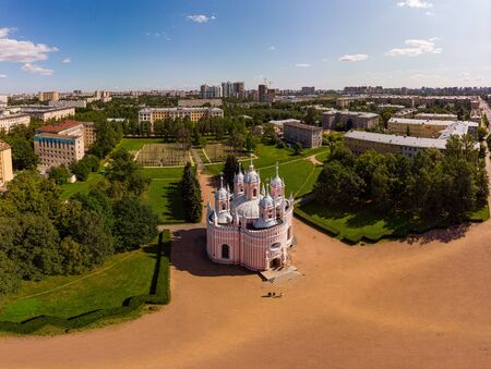 Beautiful top aerial views from drone on orthodox Church of the Birth of St John the Baptist of the Nativity (Chesme Church) in sunny summer day. Panoramic view from copter St. Petersburg, Russia