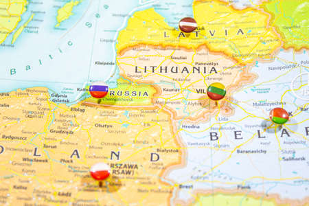 Close-up view of Baltic States on a geographical globe, Map shows capitals countries Latvia -Riga, Lithuania - Vilnus, Estonia -Tallin Poland -Krakow and Kaliningrad region of Russia and their flags