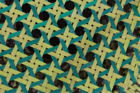 weave: Close up of the octagonal collor green and yellow weave pattern Stock Photo