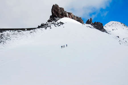 slope: Group of climbers is on snow slope