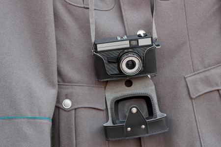 old camera on the background the fragment military jacket army East Germany photo