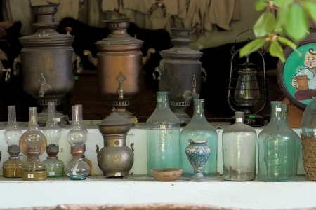 samovars glass bottles petrol lamps clothes photo