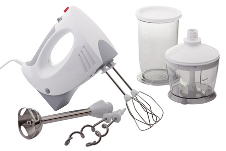 beater: Household electric mixer and special equipment on a white background  Isolated object.