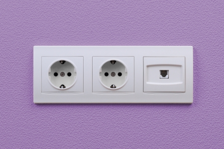 Electric and internet outlets on wall, electric cable and internet photo