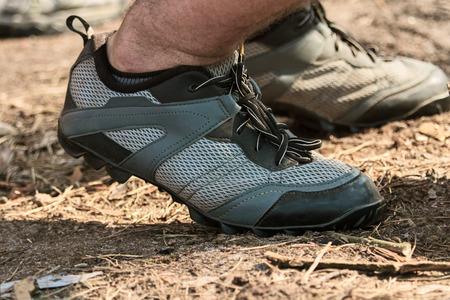 hairy legs: racing bike shoes for men dressed hairy legs closeup