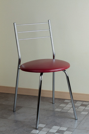comfortable chair: comfortable and contemporary chair with metal frame in the interior Stock Photo