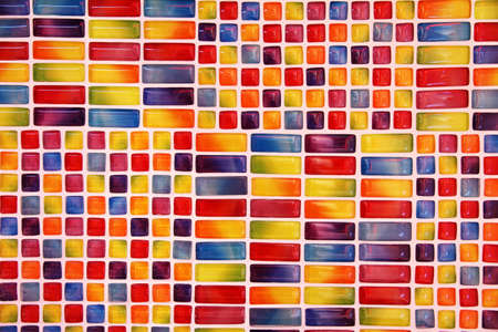 grout: colorful glass tiles with white grout on the wall