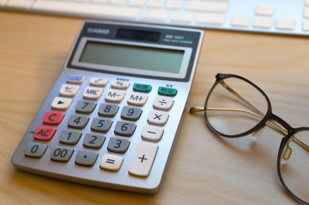 Calculator with glasses Stockfoto