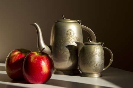 Still Life with Red Apples and Silver Coffee Pot Light and Shadows photo