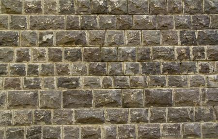 Bazalt stone (Embedded stones) wall background photo