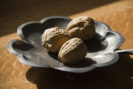 Walnuts on the decorative metal plate Stock Photo - 16429156