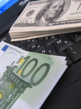 Euro and Dollars on the laptop display with stock graphics on Stock Photo - 16428411