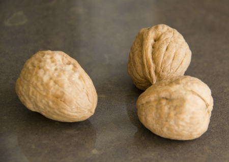 Walnuts on the brown marble background photo