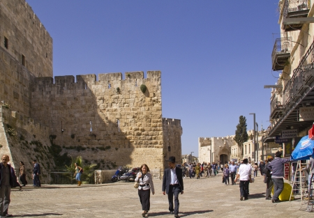 JERUSALEM - March 29,2013: Street scene in old town of Jerusalem, with Jaffa gate on Background.Jerusalem,March 29,2013
