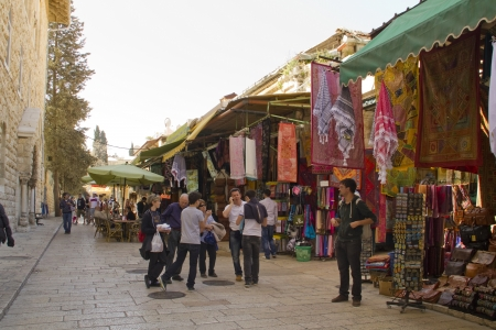 JERUSALEM - March 29,2013:  East market on narrow streets in Jerusalem Old City.The Old City is divided into four vaguely defined quarters: Christian, Armenian, Jewish and Muslim.Jerusalem,March 29,2013