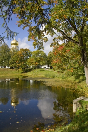 Autumn View on the pond and Feodorovsky cathedral in Tzarskoye Selo Pushkin,St Peterburg,Russia photo