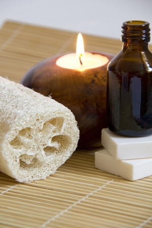 Aromatherapy Candle and Massage oil in a Zen Style Spa photo
