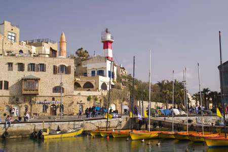 Boats and Lighthouse in old Jaffa Port  Israel  Jaffa is one of the most ancient port cities in the world Tradition says Jaffa was founded by Japheth, son of Noah, after the Flood  Andromeda Rock, facing Jaffa