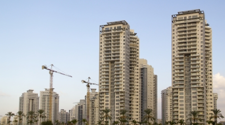 High-rise residential buildings under construction  The site with cranes  Stock Photo