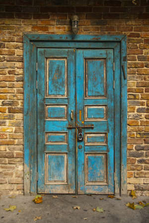 view of a wooden doorway: Old Blue Grunge Door
