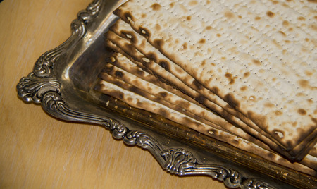 Jewish Matzoh on Decorated Silver Plate photo