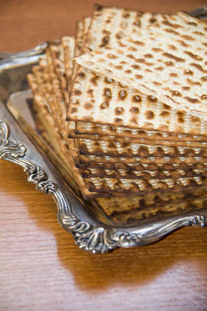 Jewish Matzoh on Decorated Silver Plate Stock Photo