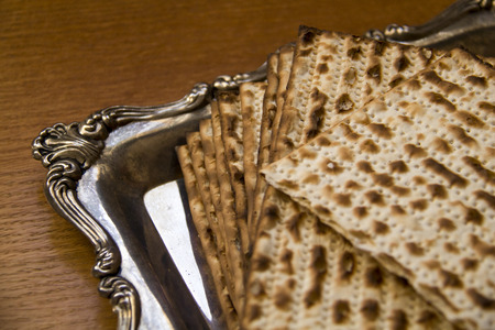 matzes: Symbols of Passover- Jewish Matza on Decorated Silver Plate.CloseUp