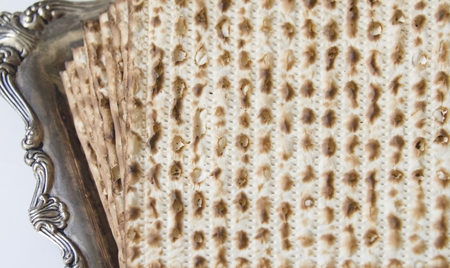 Symbols of Passover- Jewish Matza on Decorated Silver Plate.CloseUp