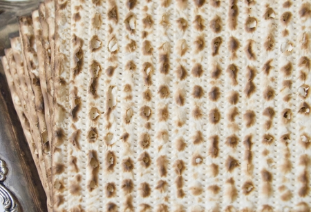 seyder: Symbols of Passover- Jewish Matza on Decorated Silver Plate.CloseUp